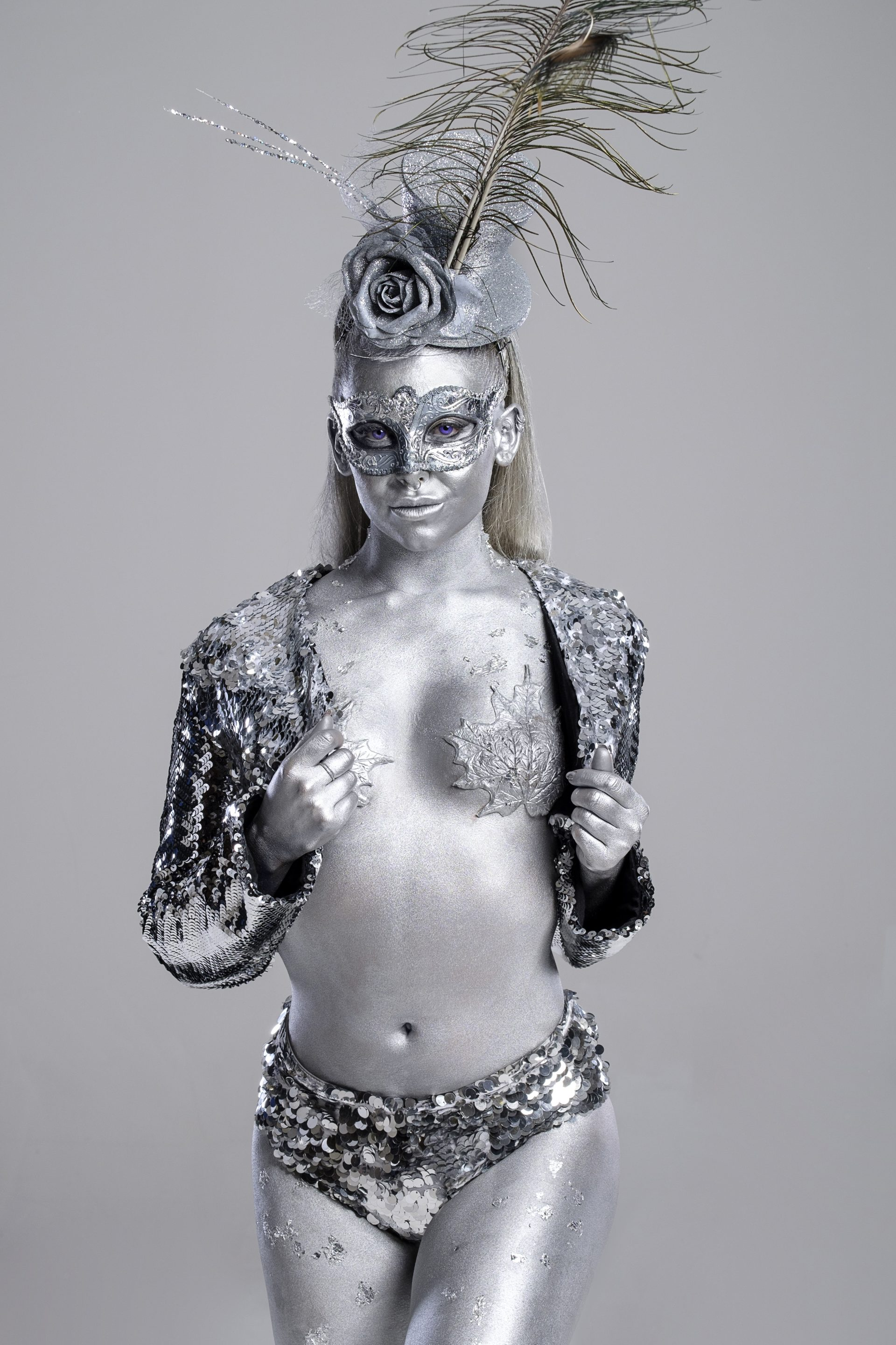 female model dancer body painted silver Christmas entertainment circus performer fire breather